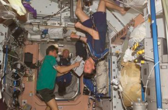 a 75 kg astronaut floating in space throws - photo #4
